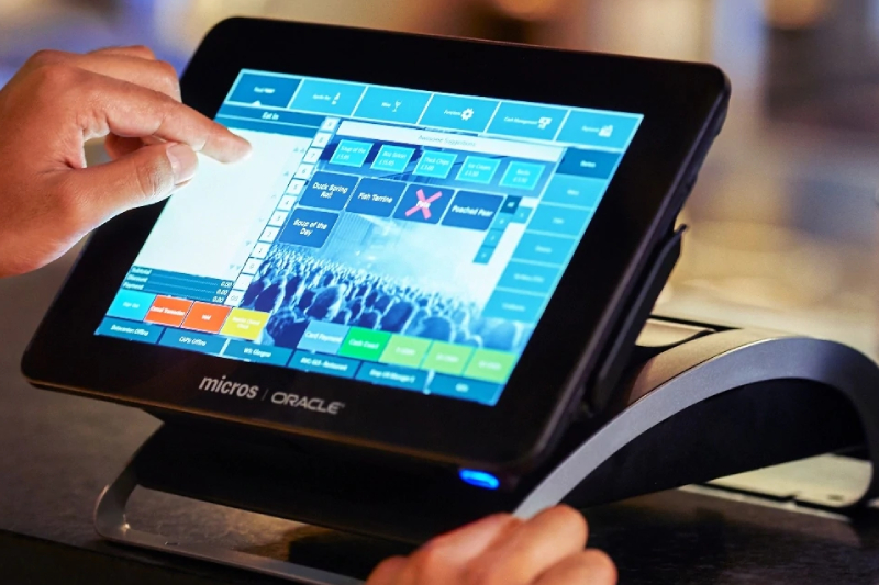 Image Showing A man pointing an object in Restaurent POS System.